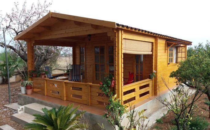 Cabañas de madera con porche de madera adosado - casas de clientes