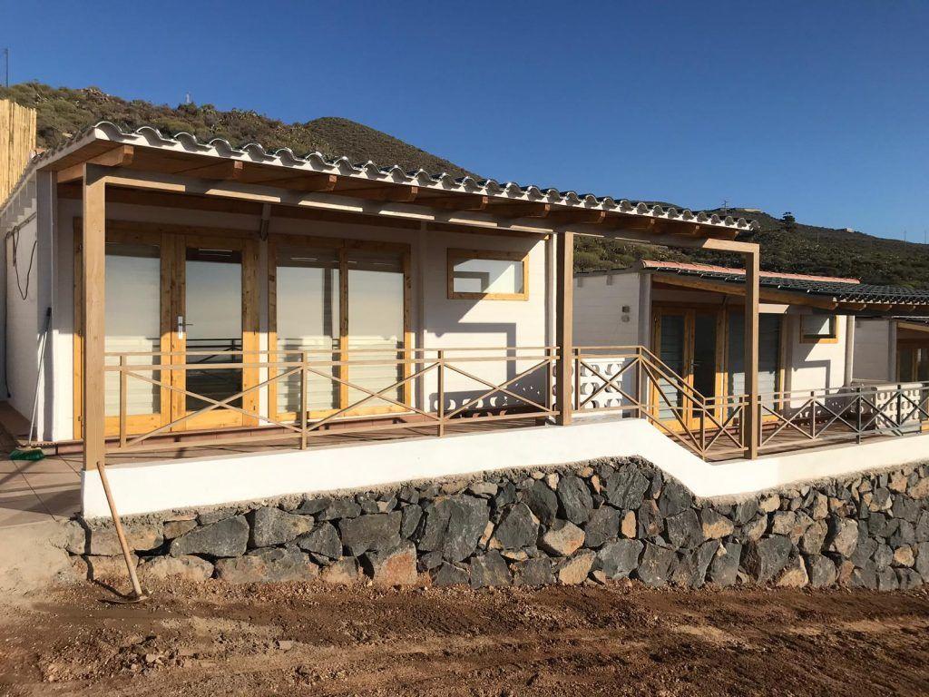 Cabañas de madera con techo plano - casas de clientes