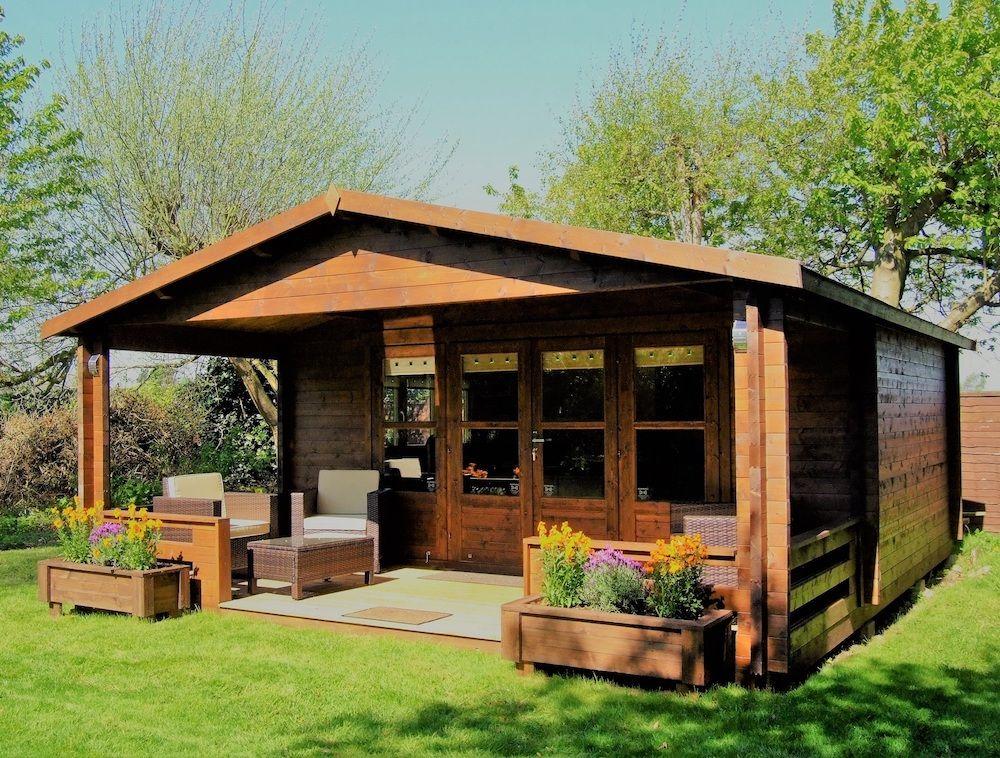 Casetas de madera con techo plano y porche adosado - casas de clientes