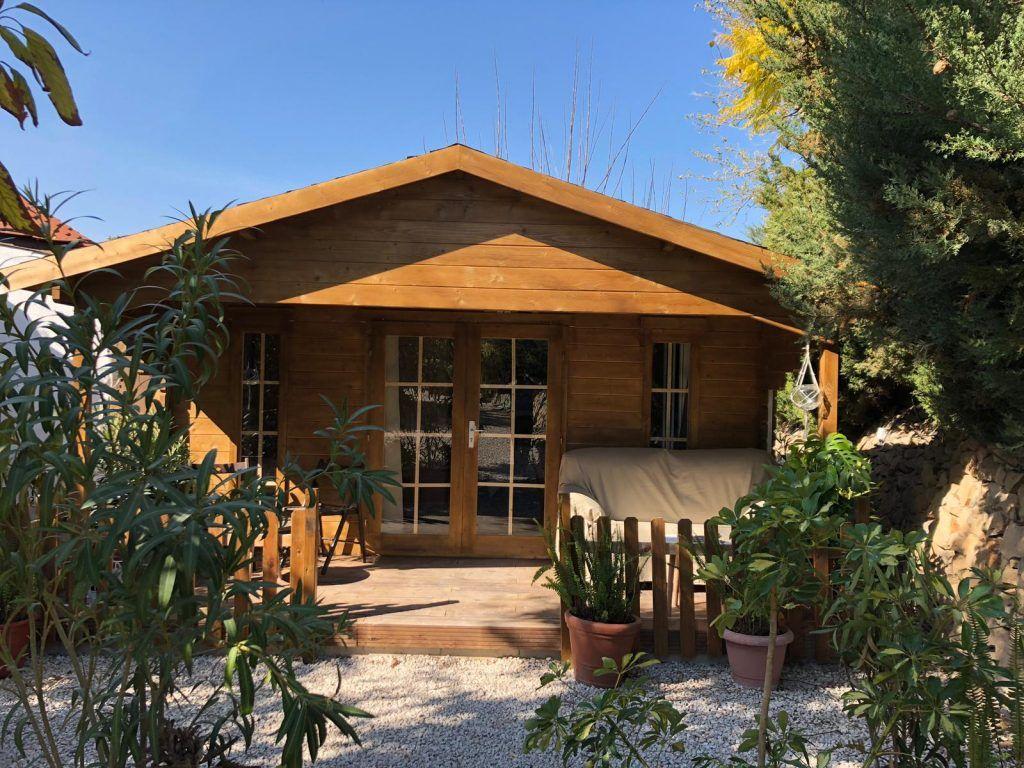 Bungalows de madera con alero - casas de clientes